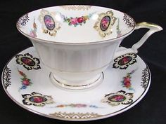 SCHUMANN BAVARIA ROSE FLORAL CAMEOS AND SWAGS TEA CUP AND SAUCER | eBay