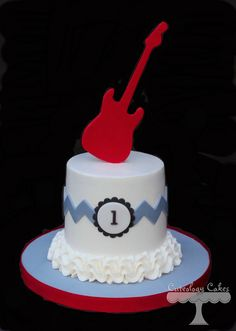 Chevron rock star smash cake for a first birthday. Electric guitar topper www.facebook.com/i.love.cuteology.cakes