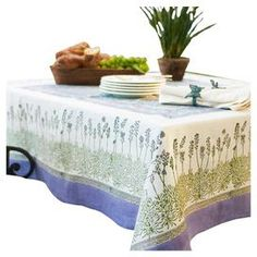 Floral-print cotton tablecloth with lavender trim.     Product: Tablecoth   Construction Material: 100% Cotton   Color: Lavender