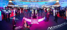 """""""International Casino Exhibition 2014&qout; (ICE) ist die bedeutendste Fachmesse der Welt. In diesem Jahr fand die Messe im ExCeL Exhibition & Conference Centre London statt. Der österreichische Glücksspielanbieter Novomatic hat vor Ort in diesem Jahr für einen besonderen Auftritt gesorgt."""