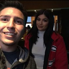 kylie jenner and fan white dress shirt red jacket coat