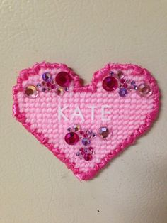 Plastic Canvas Heart Magnets with names by Cathygiftsandthings, $4.00