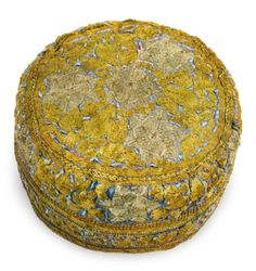 A Bukharan Kippah, 19th century - woven blue silk with silver and gold thread embroidery, lined with printed cotton. diameter 6 1/2 in.