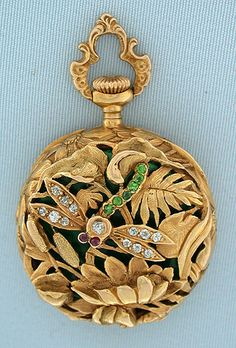 Fine and beautiful 18K gold, diamond, precious stone and enamel Art Nouveau ladies Swiss antique pendant watch circa 1895. The exceptional case cast chased and pierced with a stone set dragonfly amidst abundant foliage.
