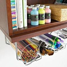 Store supplies in an under-the-shelf wine rack. | 30 Ways To Instantly Transform Your Workspace