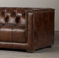 RH's Savoy Leather Sofa:Evoking the tailored elegance of English Art Deco furniture of the 1920s, our sofa features a square frame and deep button tufting. Sheltering arms envelop, and antique-brass nailheads anchor and define the supple leather.