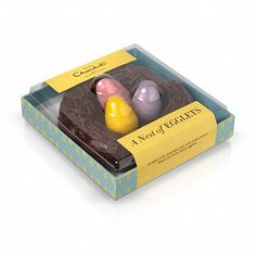 A chocolate nest with three mini chocolate Easter eggs inside, a chocolate gift for Easter from Hotel Chocolat.