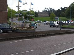 """Th """"Sea Bangor""""  ship on Upper Main Street, from the other side, before planting of the flower bed, with Bangor Town Hall on the hill in the background, in Castle Park. Bangor, Co Down , Northern Ireland."""