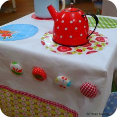 DIY Play Stove for a Kitchen - Stool slipcover made to look like a stove. Love the idea of using patchwork fabric.