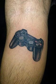 Discover Sony's iconic gaming console with the top 50 best Playstation tattoo designs for men. Explore cool video game themed and controller ink ideas. Tatoos Men, Tattos, Top Tattoos, Sleeve Tattoos, Video Game Storage, Playstation Consoles, Devil Tattoo, Gaming Tattoo, Cool Tattoos For Guys