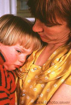 Google Image Result for http://www.sciencephoto.com/image/294294/large/M8330015-Mother_comforting_her_sick,_feverish_child-SPL.jpg