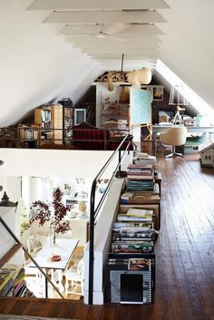 Wonderful space.Low storage along the half wall, long table, bookcases under the eaves.