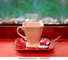 pink old style coffee cup against country background - stock photo