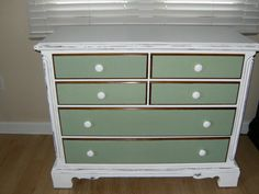http://ourlittlenestonthelake.blogspot.com/2012/05/nursery-distressed-antique-chest-of.html  Diy Drawers are decoupage with wrapping paper : )