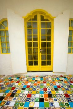 Gorgeous Architectural details including fantastic multi-tiled porcelain tiles in San Miguel de Allende, Mexico - Handmade tiles can be colour coordinated and customized re. shape, texture, pattern, etc. by ceramic design studios Yellow Doors, Handmade Tiles, Painted Floors, Interior Exterior, Mellow Yellow, Doorway, Windows And Doors, Architecture Details, Arches