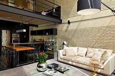 This São Paulo bachelor pad is an industrial-style loft designed by Diego Revollo for a young single lawyer. The Brazilian designer was imagined to represent the owner's personality by providing him with an open, elegant and modern Industrial Loft. Loft Estilo Industrial, Industrial Apartment, Industrial Chic, Industrial Design, Industrial Living, Industrial Interiors, Loft Design, Design Case, Diy Design