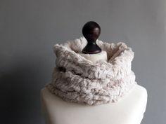 Faux fur snood in light beige with paillettes. Faux fur neck