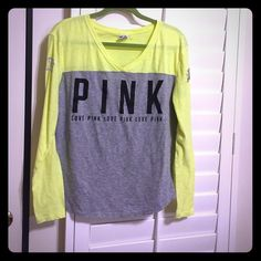 Victoria Secret v-neck baseball tee, size L Victoria Secret V neck long sleeve tee, size L Florescent Yellow and gray- great condition, only worn twice. Victoria's Secret Tops Tees - Long Sleeve