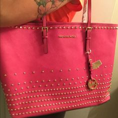 Only today !!! Michael kors jet set travel % Authentic Michael Kors jet set travel stud tote in fuschia Luxurious saffiano leather in big size . Double top handles 8'' drop.Hook tab closure. Inside: one pocket with zip and one open. Approximate 14''W Bottom 18'' top X 11.5''H X 6.5''D . Leather lining, fully lined in MK logo lining .  This bag is new with tag, never used. Comes with MK dust bag. Price is negotiable. Feel free to make a offer.  Michael Kors Bags Totes