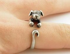 Calling all dog lovers!!! This silver puppy animal wrap ring is slightly adjustable with a gentle squeeze. It fits a size 5-9. He is sweet with rhinestone eyes and floppy ears as this little guy wraps..