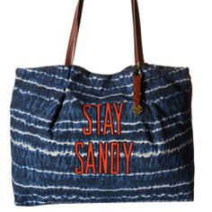 NWT Lucky Brand Beach Tote Bag Cotton and linen material flaunts an eye-catching design throughout. Magnetic snap closure. Dual flat handles with brand logo hardware key-chain. Flat-base. Interior features one zip pocket and multiple slip pockets.   Measurements Bottom Width: 16 1⁄2 in Depth: 5 in Height: 13 in Strap Length: 22 1⁄2 in Strap Drop: 10 1⁄2 in Lucky Brand Bags Totes