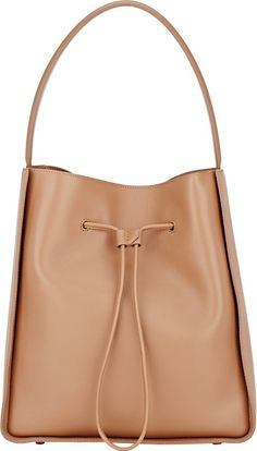 Soleil large bucket bag-brown by 3.1 Phillip Lim. 3.1 Phillip Lim camel grained leather Soleil large bucket bag. Lined with black twill, leather zi...