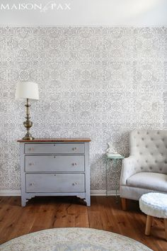 I just love this room! Gray and White Girl's Nursery: patterned stencil accent wall and soft gray and white textures create a beautiful, serene space for a little girl | maisondepax.com