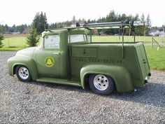 1956 Ford pickup similar to this w/o the markings or fancy wheels, and a darker shade of green. Mine had exactly this style of utility box w/o the ladder rack.