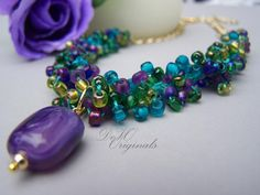 Purple & Turquoise Hand Knitted Beaded Necklace with Purple Pendant...LOVE THIS!