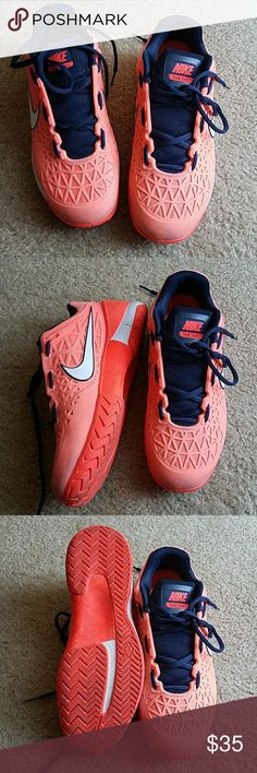 "Nike Zoom Dragon runners Pastel orange color with navy blue aacents and orange soles. Bought for running but I've discovered that my feet are shaped for Aasics runners. Nikes just don't do it for me as running shoes. No wear on soles as shoes were not worn more than a few times. My loss, your gain! Shoes have been washed and are ready for you! Please note that the ""discoloration"" on the toes are a part of this particular shoe's style. Nike Shoes Sneakers"