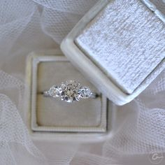 A three stone A.JAFFE engagement ring to represent your past, present and future. Style ME1854Q, ring box The Mrs. Box.