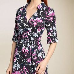DVF Classic Wrap Dress With Floral Print This gorgeous authentic Diane von Furstenberg Jessica wrap dress in her Spring Shadows Navy patterned printed silk jersey is a short sleeve version of the line's ever popular Jeanne dress.  This popular print is a gorgeous black, navy, off-white, periwinkle/light blue, and pink floral print that is versatile enough for both professional and social settings - a true classic that will be a wardrobe staple. NO trades NO returns Please consider %20…