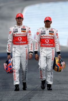 Jenson Button and Lewis Hamilton suit  up.