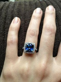 blue diamond cushion cut engagement ring / http://www.deerpearlflowers.com/20-most-loved-cushion-cut-engagement-rings/2/