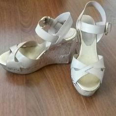 Ivanka trump wedges Leather and Cork material.  Size 6 wedges. Worn a few times. Still in great condition. I don't have shoebox anymore. purchased from Lord & taylor Ivanka Trump Shoes