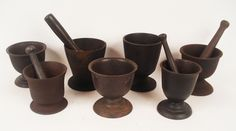 """Antique Cast Iron Mortar's.  A group of 7 antique cast iron mortars ranging in size from 4"""" to 6""""."""