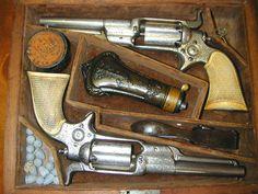 Boxed set of Colt side hammer revolvers
