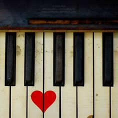 Vintage piano. Two white keys (wearing black bows) sharing the same red heart. I miss my piano. #inspiration #vintage #music #instrument #red #white #black