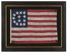 13 stars in a rare tombstone pattern on an entirely hand-sewn flag of an especially tiny scale. Dated July 4th, 1865. Silk and wool. From 2015 San Francisco Fall Antiques Show exhibitor, Jeff R. Bridgeman American Antiques.