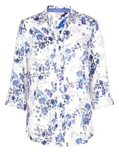Our pure cotton Willow shirt is printed with all-over florals, and adorned with frills on the button placket. The v-shaped neckline ensures a flattering fit, while roll-up sleeves create a casual finish.