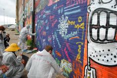 18 Yachting Journalists trying street art...in the rain!