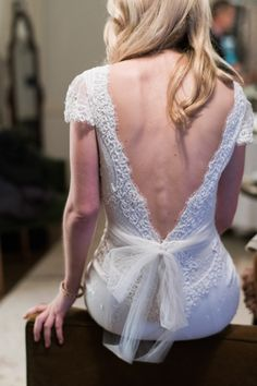 Sexy open back lace wedding dress: http://www.stylemepretty.com/new-york-weddings/new-york-city/2016/05/23/designer-dress-a-list-florist-celebrity-photographer-this-manhattan-wedding-is-a-must-see/ | Photography: Trent Bailey Studios - http://www.trentbailey.com/