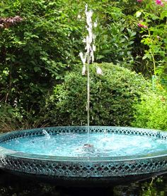 Water Features for Ponds - the Mimeo A naturally patinated bronze bowl with Moorish influences. The Mimeo gives both visual and aural stimulation with a delicate filigree pattern cut into its inner and outer edges and a single fine jet of water rising and falling from the center onto the flat central bronze plate. A choice of blue or white LED lights under the central plate produce a soft glow in the evening.
