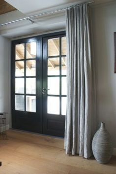 Gorgeous drapery. Love it with the black blinds and woodwork ...