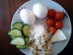 Simple food for breakfast: 2eggs, cherry tomatoes, cucumber, cheese and sauerkraut
