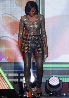 Michelle Obama presenting at the 2012 Kid's Choice Awards!  I can't imagine another First Lady in this outfit. You better WERK!!!