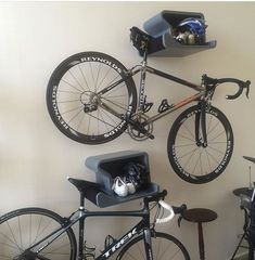 Modern indoor bike rack that looks great with or without bike. Combining sleek design with perfect function. Available in grey, granite white or black. Includes all the hardware and a black felt pad f