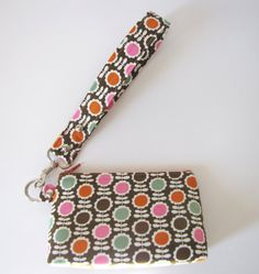 Hey, I found this really awesome Etsy listing at https://www.etsy.com/listing/110570580/pink-and-brown-retro-floral-wristlet