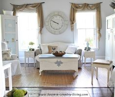 Creating Cozy Country Style on a Budget Flea market finds and hand-me-downs work together when unified with white paint. Landscape burlap swags hang from branches in the yard and cost about $10 per window.