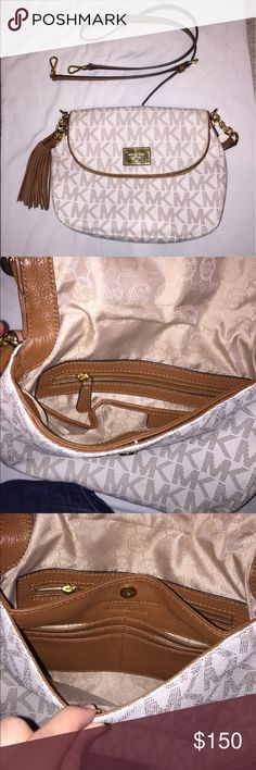 Michael Kors crossbody bag Cream and tan Michael Kors crossbody bag. This bag is authentic. You can wear it near your on your arm, or attach the crossbody strap. Perfect condition! Michael Kors Bags Crossbody Bags